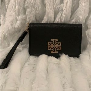 Never used Tory Burch Britton smart phone wallet.